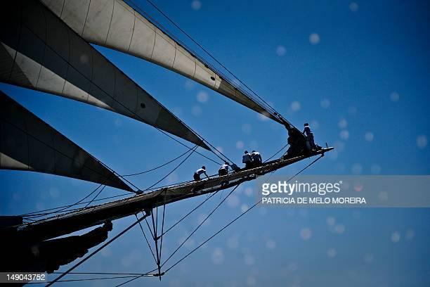 Crew members of Spanish sailing boat Juan Sebastian De Elcano works on board in Lisbon on July 22 during the Tall Ships' races 2012 an international...