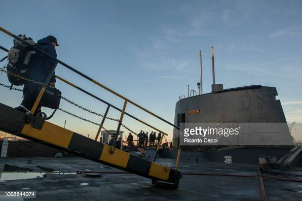 Crew members of submarine ARA San Juan embark for an expedition after the mid-life upgrade reparation at Tandanor shypyard on June 02, 2014 in Buenos...