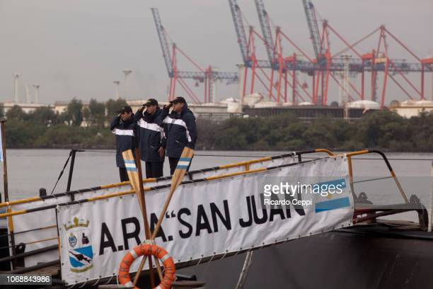 Crew members of submarine ARA San Juan embark to set sail after the mid-life upgrade reparation at Tandanor shypyard on May 23, 2014 in Buenos Aires,...