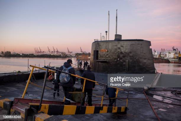 Crew members of submarine ARA San Juan embark to set sail after the mid-life upgrade reparation at Tandanor shypyard on June 02, 2014 in Buenos...