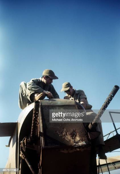 Crew members of the 98th Bombardment Group work on wreckage at the US Air Force Base in Benghazi Libya