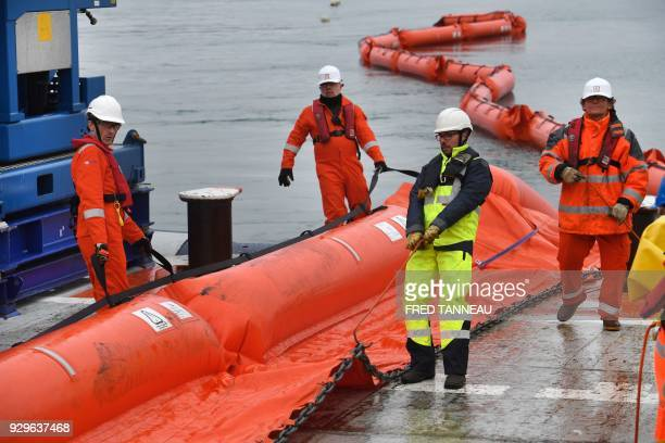 Crew members of the antipollution vessel Argonaute unwind a floating dam during a drill on March 6 2018 in Brest western France On March 16 1978 the...