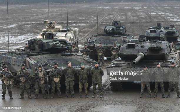 Crew members of the battle tanks Leopard 2 and the armored personnel carrier Puma of the German Bundeswehr during a training at the Bundeswehr...