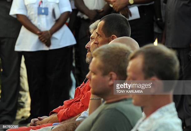 Crew members of the Belize flagged transport vessel MV Faina sit during an address by acting captain Viktor Nikolsky on February 12 2009 The ship has...