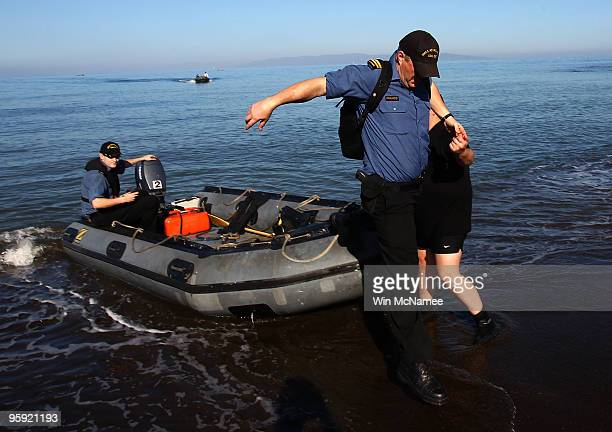 Crew members of the Canadian Navy vessel HMCS Athabaskan step ashore in the city of Leogane on January 21, 2010 in Leogane, Haiti. Forces from the...