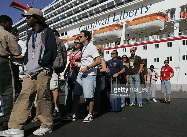 Crew members of the Carnival Liberty Cruise ship disembark at Port Everglades on November 19 2006 in Fort Lauderdale Florida More than 700 passengers...