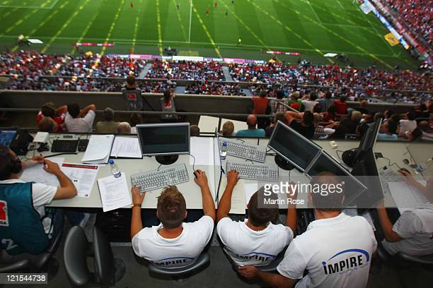 Crew members of the Impire tracking team analyse the players' running distance during the Bundesliga match between FC Bayern Muenchen and Hamburger...