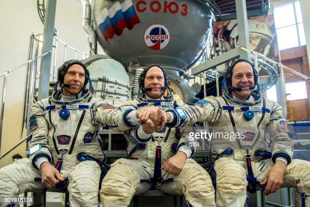 Crew members of the International Space Station expedition 5556 NASA astronauts Andrew Feustel Roscosmos cosmonaut Oleg Artemyev and Richard Arnold...
