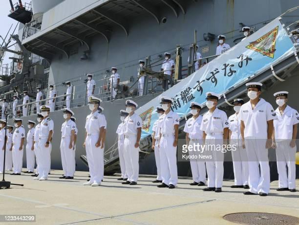 Crew members of the Japanese Maritime Self-Defense Force destroyer Suzunami line up at the Ominato base in Mutsu in Aomori Prefecture, northeastern...