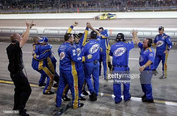 Crew members of the Miller Lite Dodge driven by Brad Keselowski celebrate after winning the series championship and finishing in fifteenth place for...