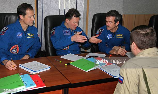 Crew members of the next expedition to the International Space Station Canadian astronaut Chris Hadfield Russian cosmonaut Roman Romanenko and US...