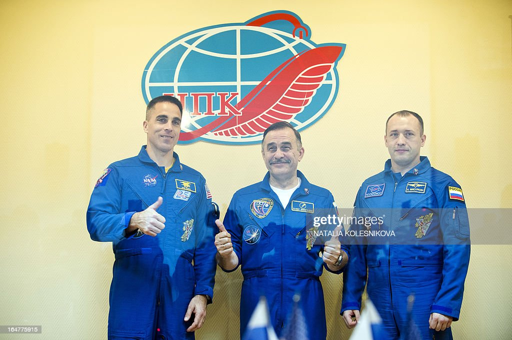 Crew members of the next expedition to the International Space Station (ISS), (L-R) US astronaut Christopher Cassidy, Russian cosmonauts, Pavel Vinogradov and Alexander Misurkin, pose for a photo during a press conference at the Russian leased Kazakhstan's Baikonur cosmodrome, on March 27, 2013. The launch of the Soyuz TMA-08M spacecraft with Cassidy, Vinogradov and Misurkin aboard is scheduled on March 29.
