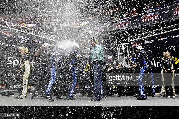 Crew members of the No 48 My Lowe's Chevrolet celebrate after winning the NASCAR Sprint Pit Crew Challenge at Time Warner Cable Arena on May 17 2012...