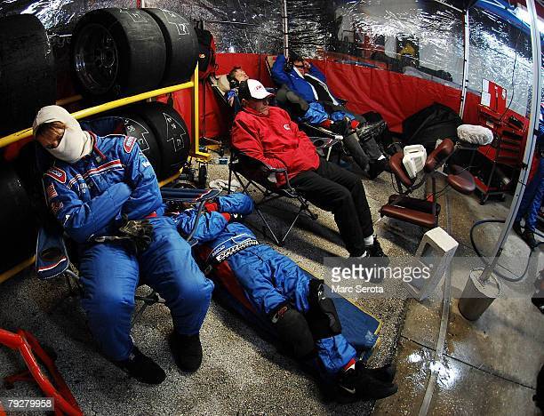 Crew members of the Porshe Riley Brumos Porshe racing team sleep on pit row during the Rolex 24 on January 26, 2008 at Daytona International Speedway...