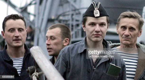 Crew members of the Russian minisubmarine AS28 Priz crew arrive at PetropavlovskKamchatsky 07 August 2005 Seven Russian sailors trapped for three...