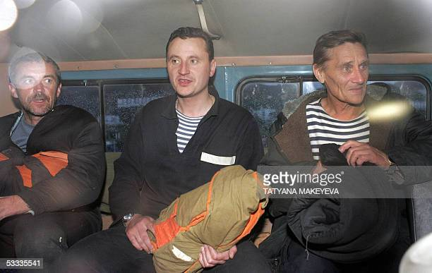 Crew members of the Russian minisubmarine AS28 Priz sit in a bus on the way to the local hospital after their arrival at PetropavlovskKamchatsky 07...