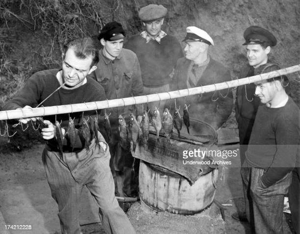 Crew members of the scuttled German liner Columbus pass their time fishing while they are interned at the Angel Island Immigration Station San...