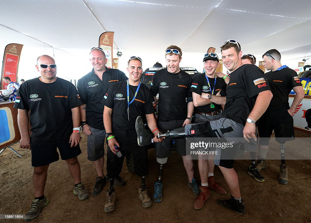 Crew members of the team Race 2 Recovery consisting of British and American soldiers who have suffered serious injuries in the conflicts in Iraq and Afghanistan in recent years, joke in Lima on Jan...
