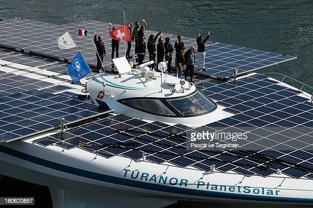 Crew members of the Turanor PlanetSolar largest solar vessel in the world powered exclusively by the sun wave to the crowd as they depart to Lorient...