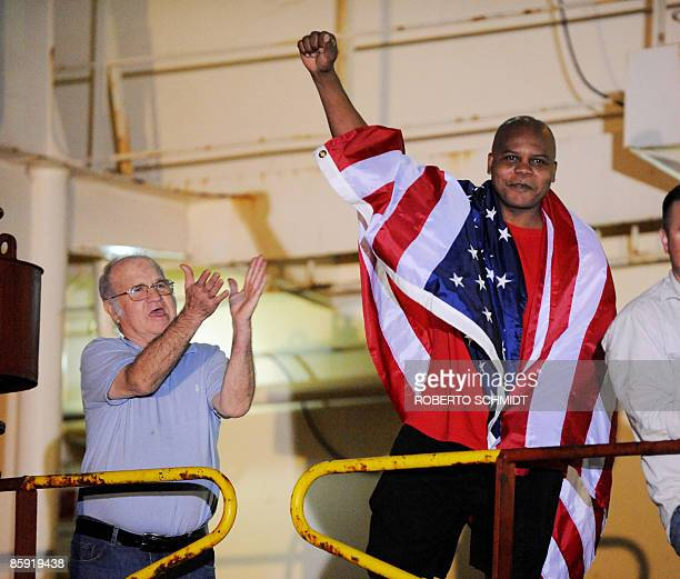 Crew members of the US merchant ship Maersk Alabama exault as they speak with the media representatives moments after hearing that the captain of...