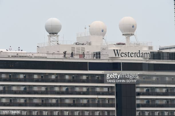 Crew members of the Westerdam cruise ship work on the top deck as it remains docked in Sihanoukville on February 19 2020 Cambodia's strongman premier...