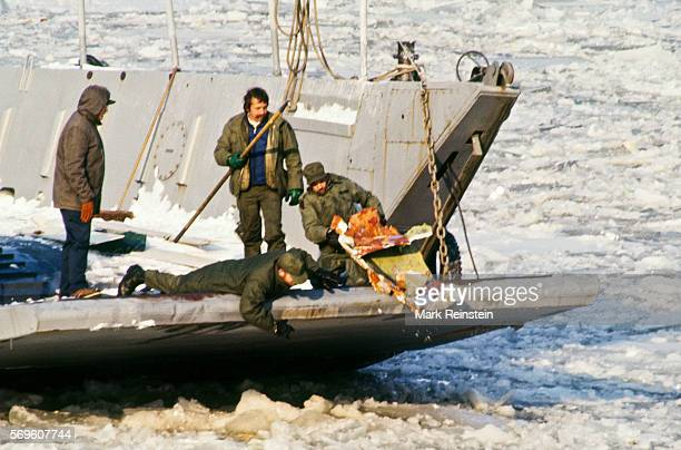 Crew members on an LCM pulls life raft over the vessel's partially lowered ramp during the salvage of Air Florida Flight 90 Washington DC January 16...