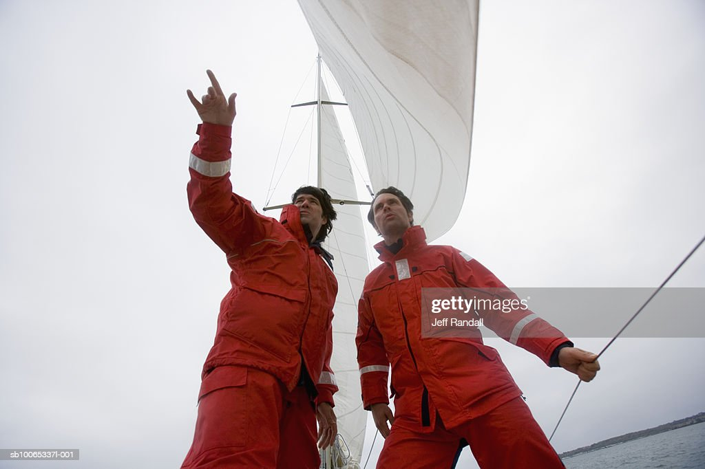 Crew members on racing yacht, low angle view : Foto stock