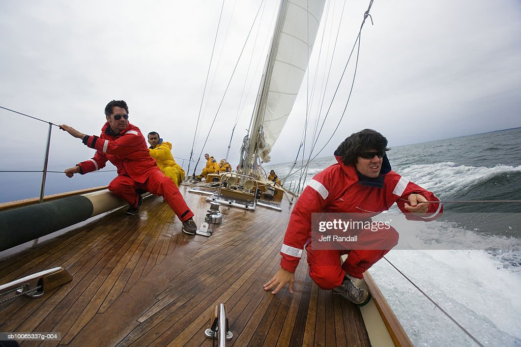 Crew members on racing yacht : Foto stock