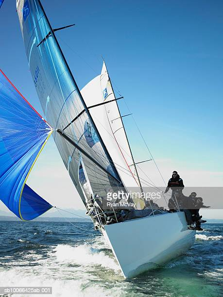 Crew members on racing yacht