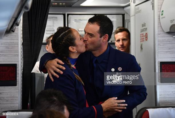 TOPSHOT Crew members Paula Podest and Carlos Ciuffardi kiss after being married by Pope Francis during the flight between Santiago and the northern...