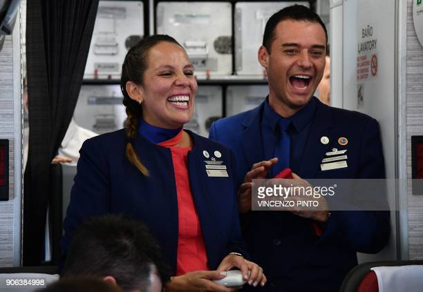 Crew members Paula Podest and Carlos Ciuffardi smile after being married by Pope Francis during the flight between Santiago and the northern city of...