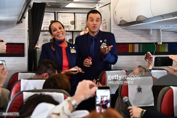 Crew members Paula Podest and Carlos Ciuffardi talk to people on the plane moments after being married by Pope Francis during the flight between...