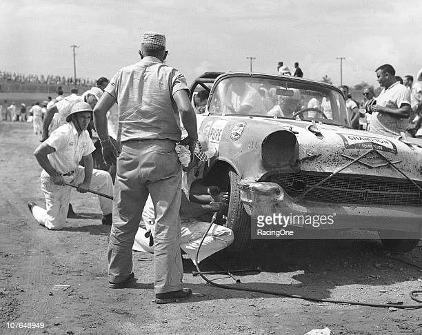 Crew members pit a 1957 Chevrolet during a NASCAR Convertible Series race at AshevilleWeaverville Speedway