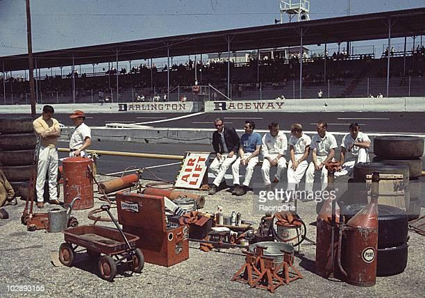 Crew members prepare for a race at Darlington Raceway.