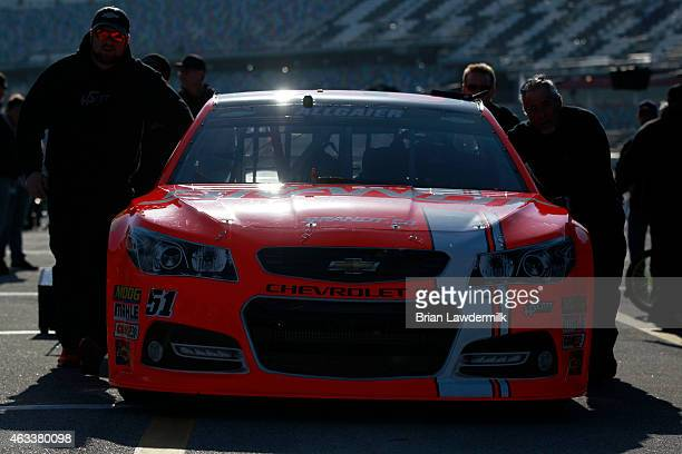 Crew members push the Brandt Chevrolet through the garage area during practice for the NASCAR Sprint Cup Series 3rd Annual Sprint Unlimited at...