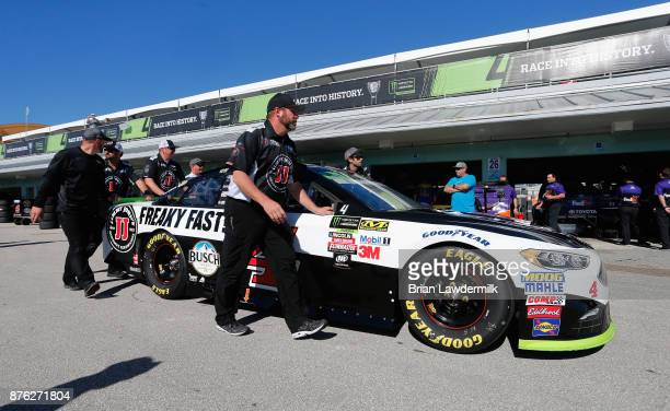 Crew members push the Jimmy John's Ford of Kevin Harvick through the garage area during the Monster Energy NASCAR Cup Series Championship Ford...