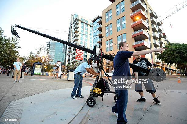 Crew members roll out the jib boom camera at the American Idol Auditions at PETCO Park on July 8 2011 in San Diego California