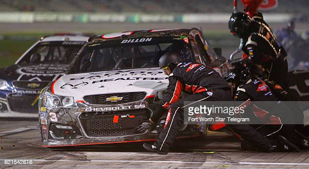 Crew members service Austin Dillon's car at the AAA Texas 500 on Sunday, Nov. 6, 2016 at Texas Motor Speedway in Fort Worth, Texas.