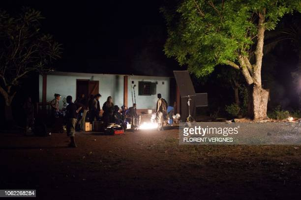 Crew members sets up a scene in the middle of the night in a village on November 7 2018 during the filming of Camille based on the life of French...