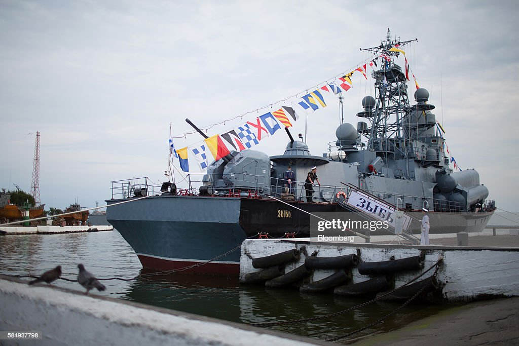 Crew members stand aboard a Zyb small missile warship flying its signal flags to celebrate during Russian Navy day at the Vistula lagoon in Baltiysk, Russia, on Sunday, July 31, 2016. Amid Russia's recent rearmament, the Kaliningrad region has increasingly returned to its Soviet-era role as a garrison on the strategic Baltic Sea coast. Photographer: Andrey Rudakov/Bloomberg via Getty Images
