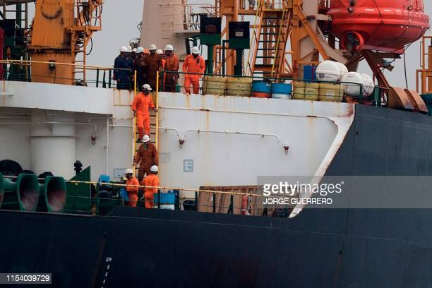 Crew members walk down a ladder on board supertanker Grace 1 off the coast of Gibraltar on July 6 2019 Iran demanded on July 5 2019 that Britain...