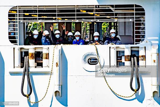 Crew members wearing face masks as a precaution against the spread of corona virus, after the ship docked. Cruise ship Regal Princess has docked in...