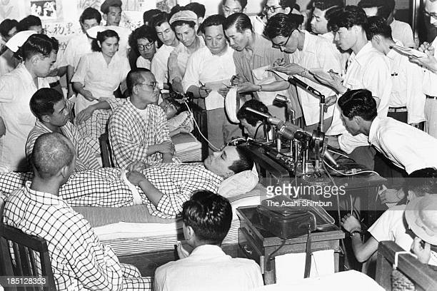 Crew members, while some of them lying on the bed, of Dai 5 Fukuryu Maru attend a press conference at Tokyo University on August 5, 1954 in Tokyo,...