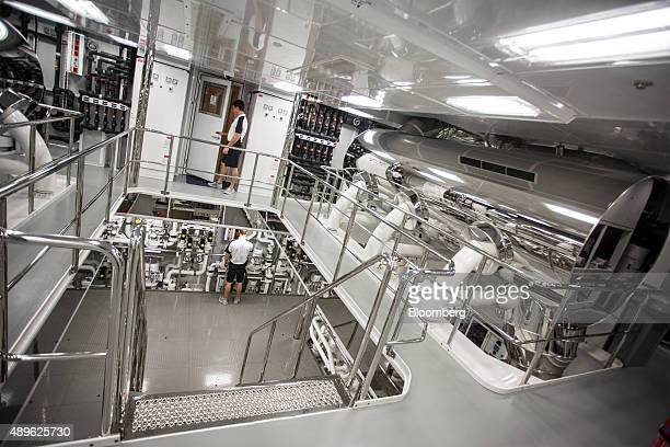 Crew members work in the engine room beneath deck aboard the luxury superyacht Solandge built by Lurssen Werft GmbH Co KG during the Monaco Yacht...