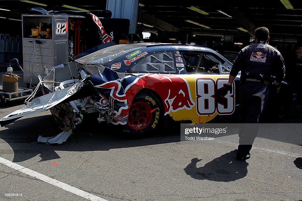 Crew members work on the car of Boris Said, driver of the #83 Red Bull Toyota, in the garage during the NASCAR Sprint Cup Series Heluva Good! Sour Cream Dips at Watkins Glen International on August 8, 2010 in Watkins Glen, New York.