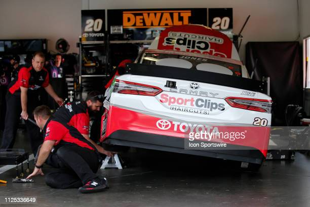 Crew members work on the car of Erik Jones driver of the Joe Gibbs Racing Sport Clips Toyota Camry during final practice for the Daytona 500 on...