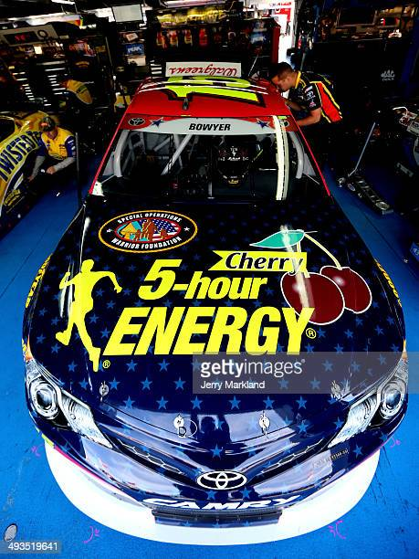 Crew members work on the Cherry 5hour Energy for Special Operations Warrior Foundation Toyota in the garage area during practice for the NASCAR...