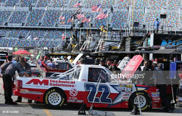 Crew members work on the DontMessWithTexas/AMTechSolutions Chevrolet during practice for the NASCAR Camping World Truck Series NextEra Energy...