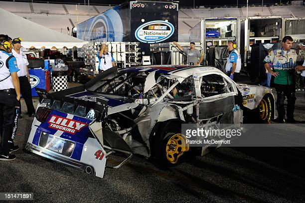 Crew members work on the Lilly Trucking CDL Driver Search Ford driven by Timmy Hill during the NASCAR Nationwide Series Virginia 529 College Savings...
