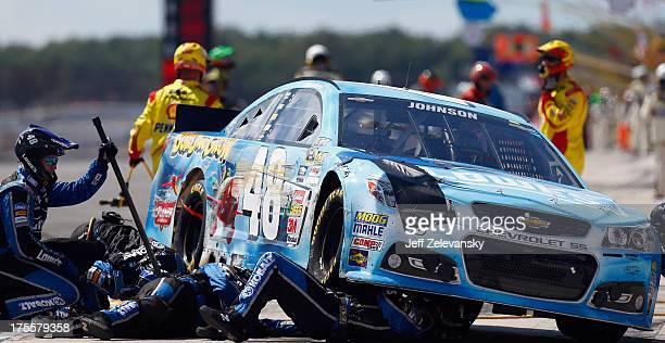 Crew members work on the Lowe's Planes Chevrolet driven by Jimmie Johnson following an incident during the NASCAR Sprint Cup Series GoBowlingcom 400...